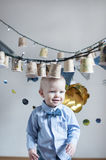 Adorable  happy  baby  boy on his birthday party. Stock Photography