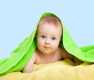 Adorable happy baby in colorful towel royalty free stock photos