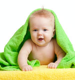 Adorable happy baby in colorful towel. S Royalty Free Stock Image