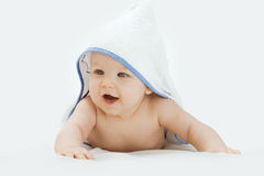 Adorable happy baby in towel Stock Photography