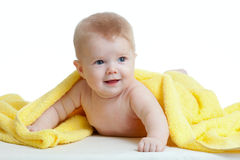Adorable happy baby in yellow towel. After bath Stock Photos