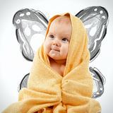 Adorable happy baby in yellow towel Royalty Free Stock Photos