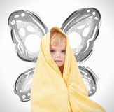 Adorable happy baby in yellow towel Stock Photo