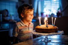 Adorable happy blond little kid boy celebrating his birthday. royalty free stock photos