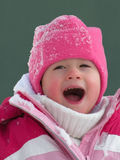 Adorable Happy Child. Adorable Beautiful happy child's face in winter with snow Royalty Free Stock Images