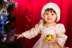 Adorable happy christmas child in santa hat Stock Photo