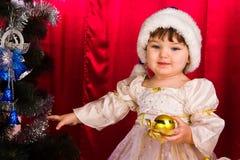 Adorable happy christmas child in santa hat Stock Photo