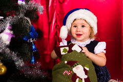 Adorable happy christmas child in santa hat Stock Photos