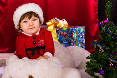Adorable happy christmas child in santa hat Royalty Free Stock Image