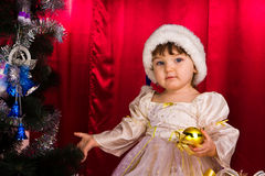 Adorable happy christmas child in santa hat Royalty Free Stock Photos