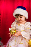 Adorable happy christmas child in santa hat Royalty Free Stock Images