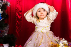 Adorable happy christmas child in santa hat Stock Images
