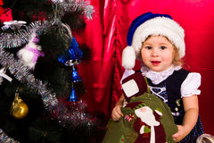 Adorable happy christmas child in santa hat Stock Photography