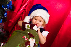 Adorable happy christmas child in santa hat Royalty Free Stock Photo