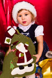 Adorable happy christmas child in santa hat Royalty Free Stock Photography