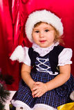 Adorable happy christmas child in santa hat Stock Image
