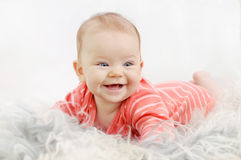 Adorable happy cute little girl with wide smile Stock Image