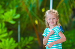 Adorable happy girl at beach with colorful little Stock Image