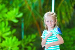 Adorable happy girl at beach with colorful little Stock Photo