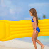 Adorable happy girl with inflatable air mattress Stock Photo