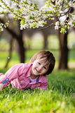 Adorable happy kid outdoors on spring day Stock Image