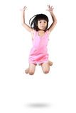 Adorable and happy little asian girl jumping in air Royalty Free Stock Photography