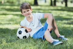 Free Adorable Happy Little Boy Resting In Grass Stock Photos - 129162443