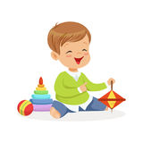 Adorable happy little boy sitting on the floor playing with toys, colorful character vector Illustration Stock Photo
