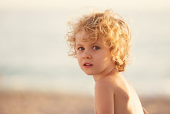 Adorable happy little girl on beach vacation Stock Image