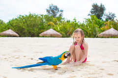 Adorable happy little girl with colorful parrot Stock Photography