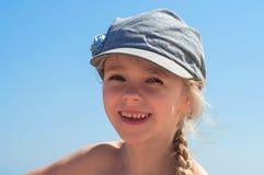 Adorable happy little girl in denim cap Royalty Free Stock Photo