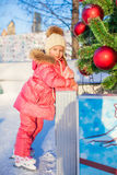 Adorable happy little girl enjoying skating at the Royalty Free Stock Photos