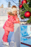 Adorable happy little girl enjoying skating at the Royalty Free Stock Images