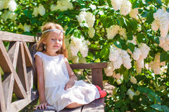 Adorable happy little girl in flower blossoming Stock Photography