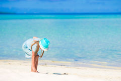 Adorable happy little girl in hat on beach Royalty Free Stock Photo
