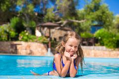 Adorable happy little girl have fun in the Stock Images