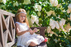 Adorable happy little girl have fun in flower Stock Photos