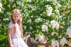 Adorable happy little girl have fun in flower Royalty Free Stock Image