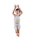 Adorable and happy little girl jumping in air. Stock Photography