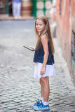 Adorable happy little girl outdoors in european city. Portrait of caucasian kid enjoy summer vacation in Rome Royalty Free Stock Photography