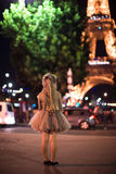 Adorable happy little girl in Paris background the Eiffel tower in the evening lights. Adorable little girl in Paris background the Eiffel tower in France Stock Images