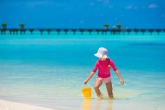 Adorable happy little girl at shallow water with Royalty Free Stock Photo