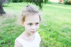 Adorable happy little girl in spring park stock photos