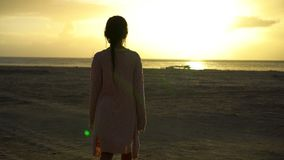 Adorable happy little girl walking on white beach at sunset stock footage