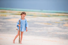 Adorable happy little girls have fun at shallow water on beach vacation Royalty Free Stock Photos