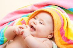 Adorable happy smiley baby after bath stock photos