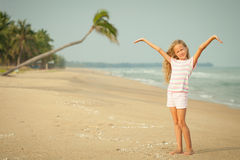 Adorable happy smiling girl on beach Royalty Free Stock Photos