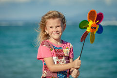 Adorable happy smiling girl on beach vacation Stock Images
