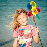 Adorable happy smiling girl on beach vacation Stock Image
