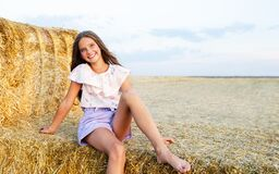Free Adorable Happy Smiling Ittle Girl Child Sitting On A Hay Rolls In A Wheat Field Royalty Free Stock Image - 194737416